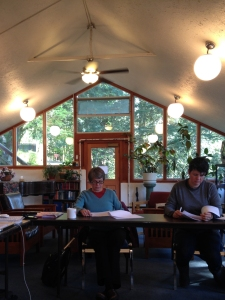 Ann Sihler and Kerry McPherson write in the Greenhouse photo by Dave King